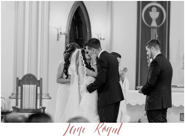 bride and groom kissing at the altar in New Jersey
