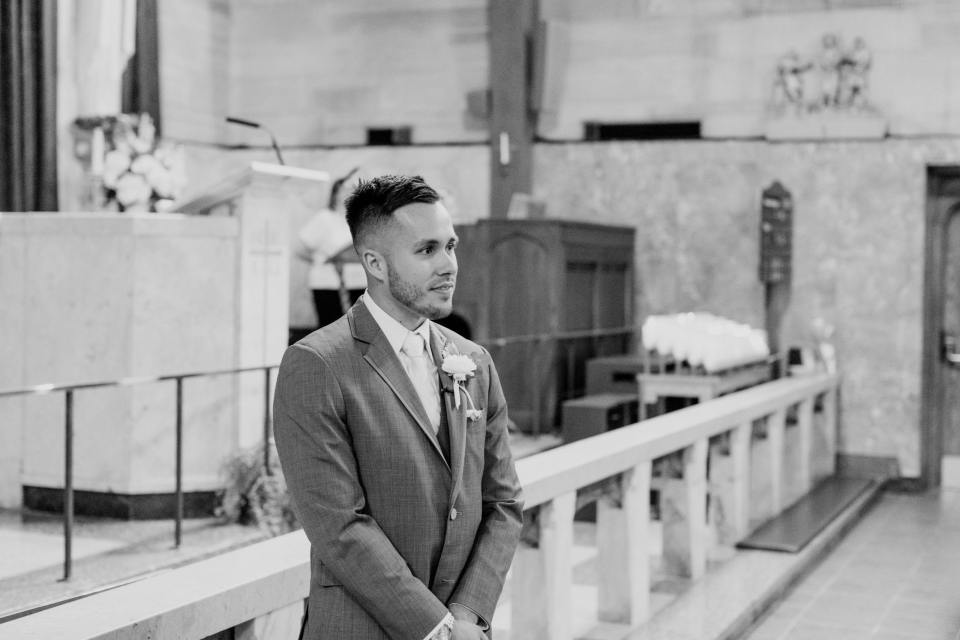 groom awaiting his bride, candid ceremony photo, black and white photo