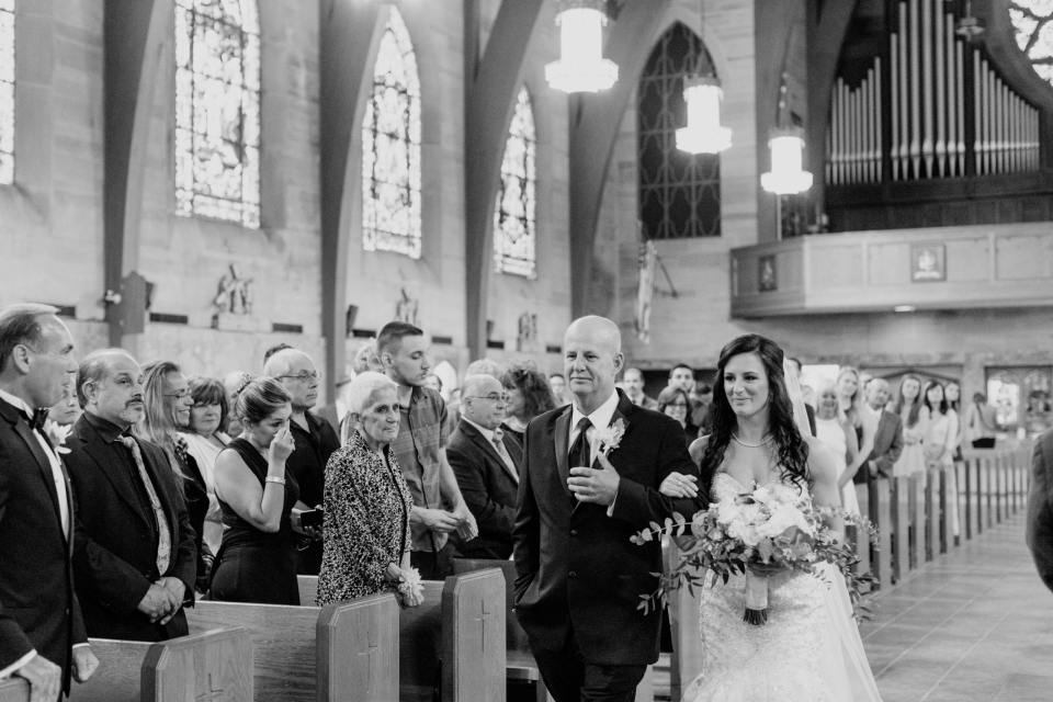 here comes the bride, father of the bride, black and white photo