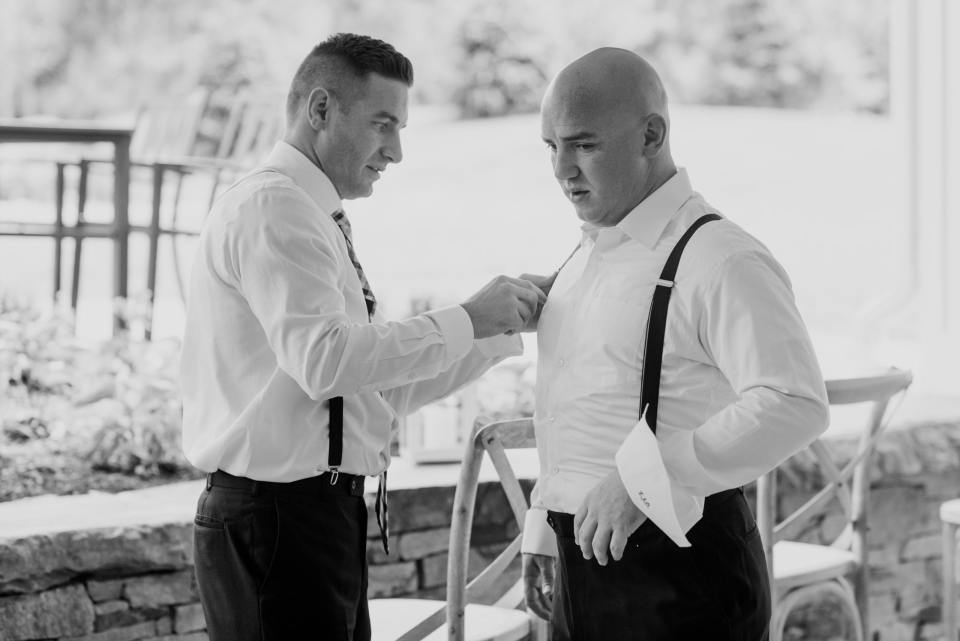 black and white groom getting ready photo