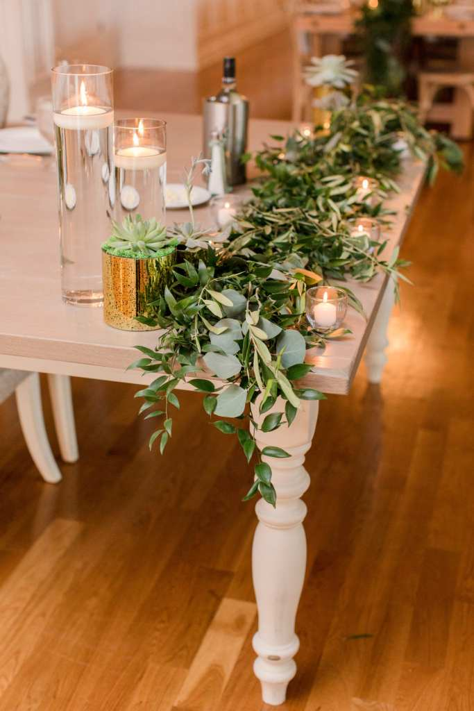 eucalyptus and greenery at the sweet heart table