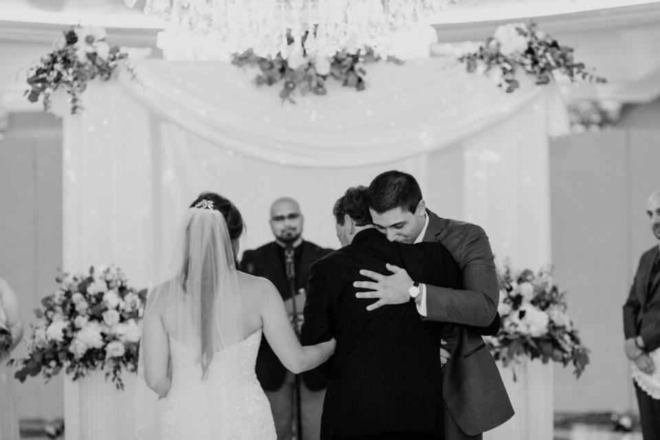 father and groom embrace, heartwarming photo between father of bride and groom, black and white photo