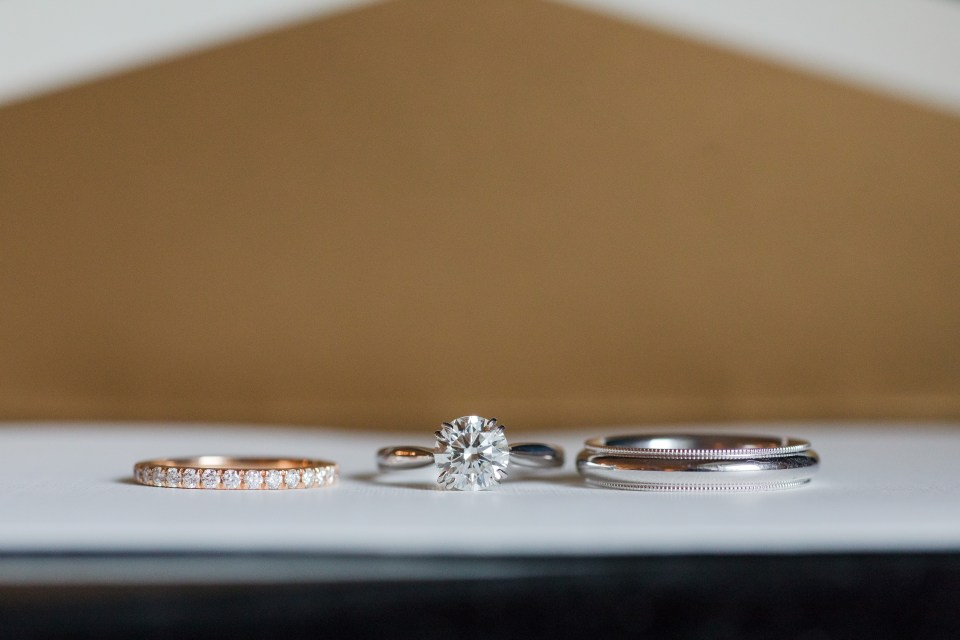 round diamond solitaire engagement ring with rose gold diamond eternity band, platinum wedding band for him, Hamilton Jewelers