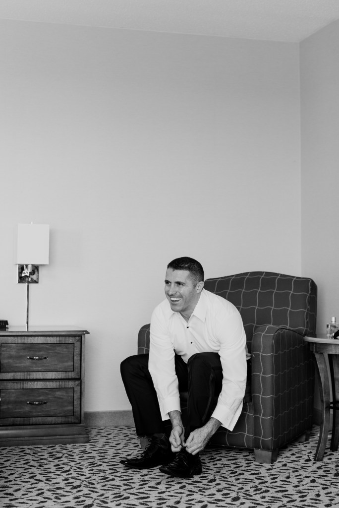 black and white groom candid photo, groom getting ready candid