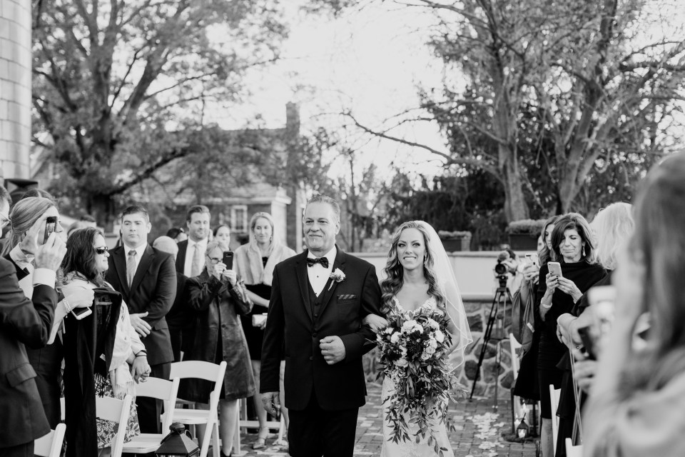 father of the bride walks the bride down the aisle, black and white wedding ceremony photo, Ryland Inn wedding ceremony