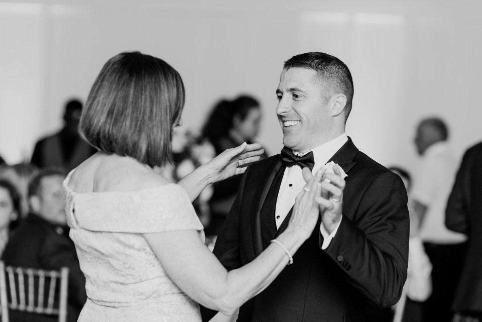 mother of groom and groom dance, black and white candid wedding dance photo
