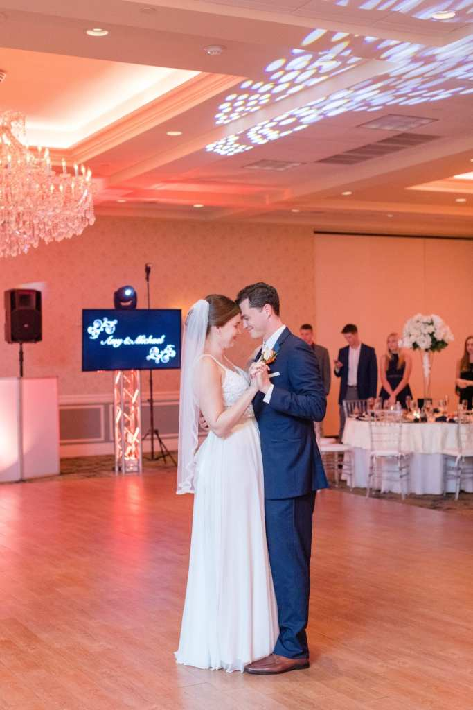 full length shot of bride and groom during their first dance