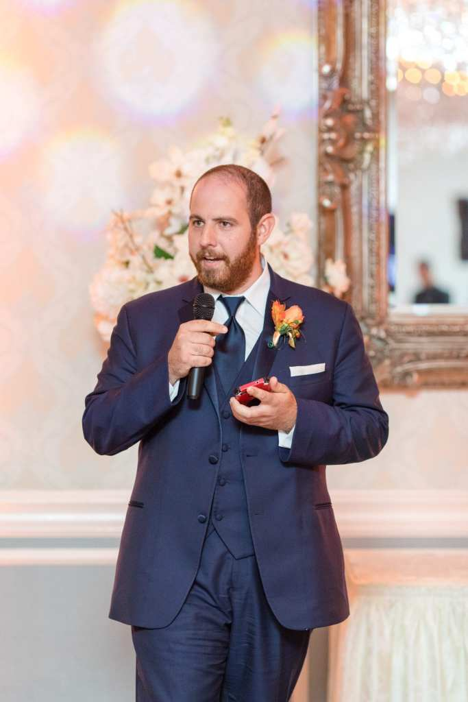 best man holding microphone to make his speech