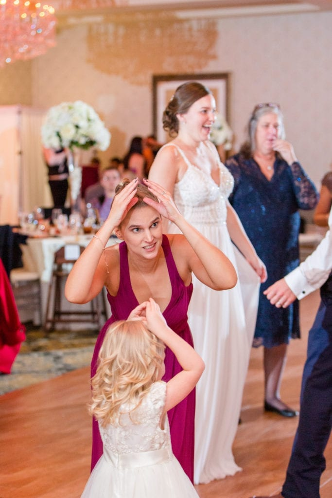 bride, bridal party and guests dancing during reception