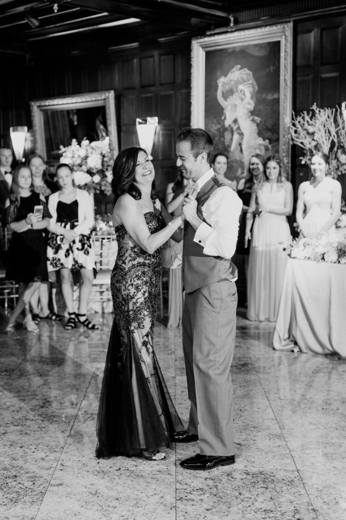 black and white photo of groom dancing with his mother