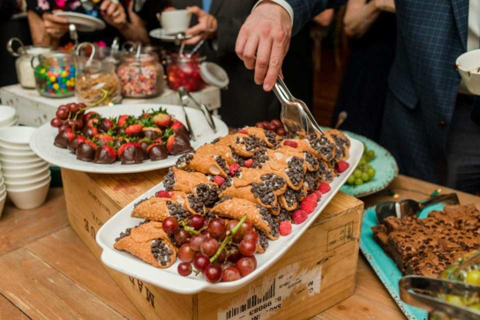 Mini cannoli and chocolate dipped strawberries as part of the Viennese display at Bear Brook Valley wedding
