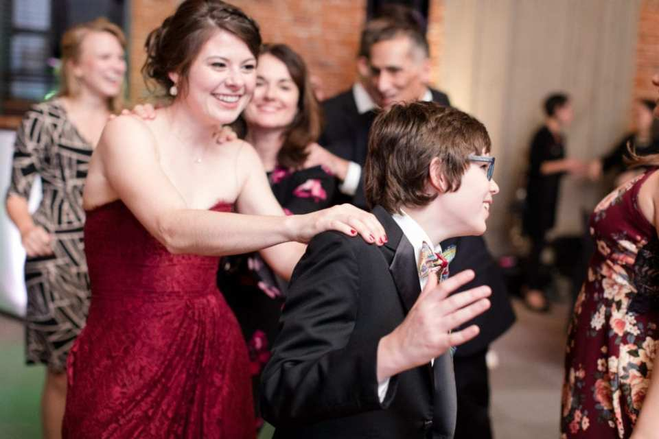 guests doing a Conga line during wedding reception