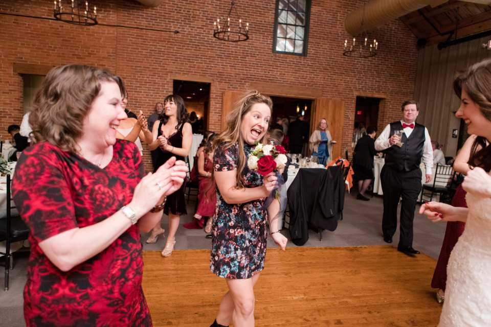 guest fun dancing after the bouquet has been tossed