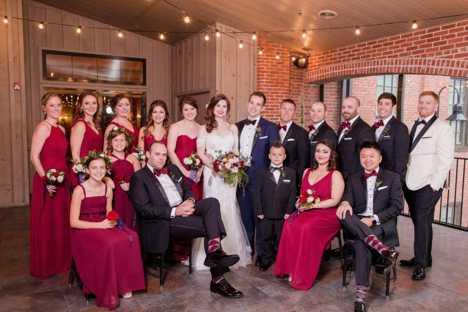 formal wedding party photo inside under cafe lights