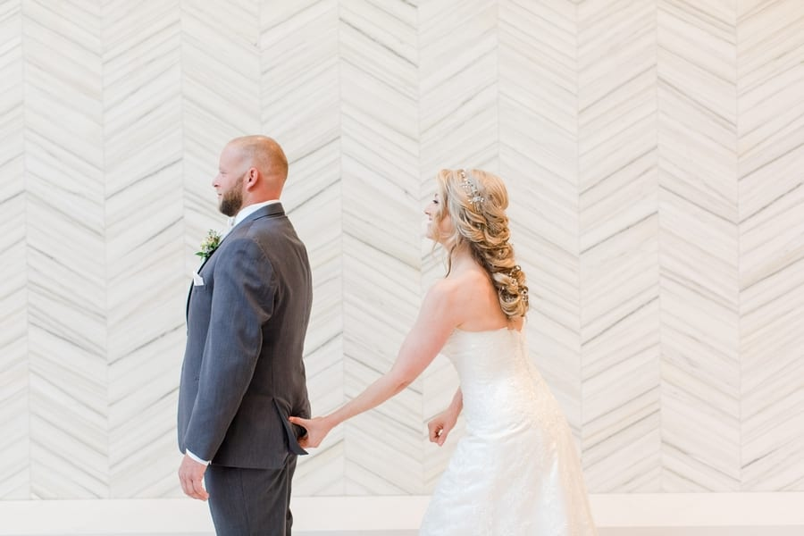 bride pinching grooms butt during first look