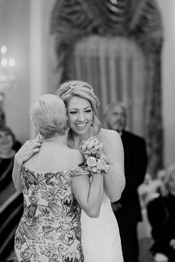 black and white photo of bride dancing with her mom