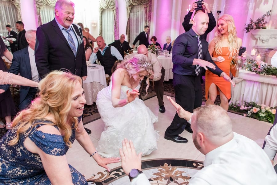 bride getting low during reception