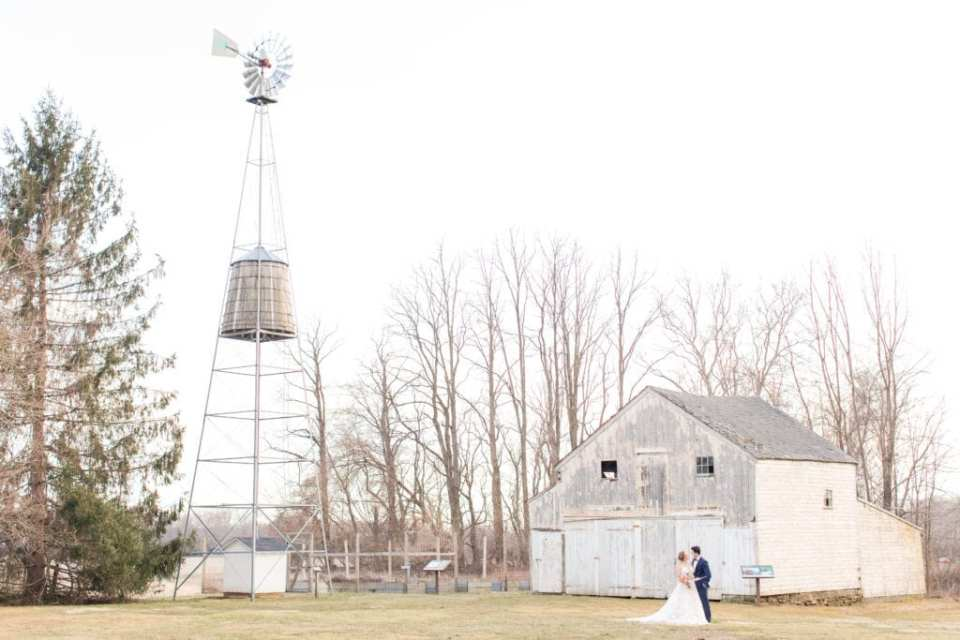 wide shot of Updike Farmstead in Princeton New Jersey with bride and groom in front of barn
