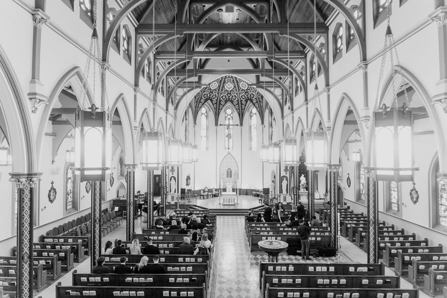 wide angle black and white shot of entire church before ceremony