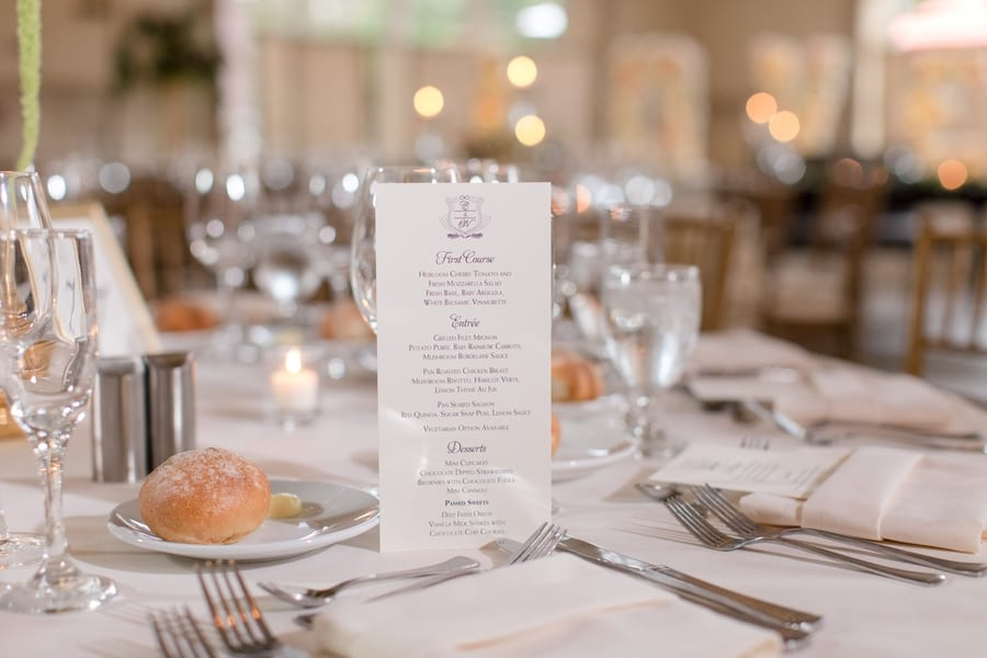 dinner reception menu displayed on table with place setting