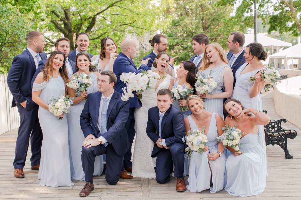 Silly bridal party photo, with bridal party in light blue Watters gowns and the groomsmen in navy blue Jos. A. Banks suits