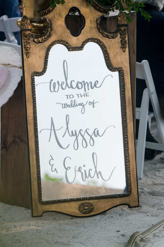 Antique mirror personalized to welcome guests to the wedding