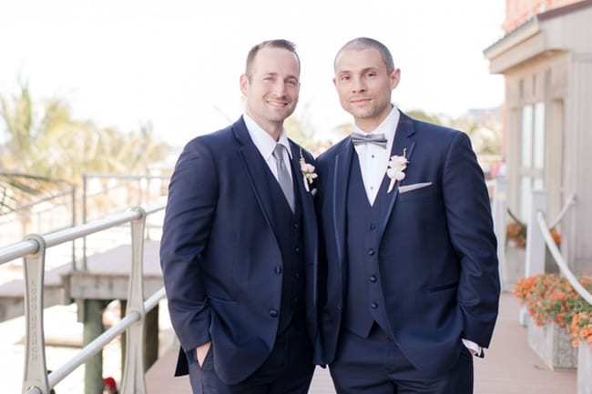 Formal portrait of the groom with his best man outside on the boardwalk