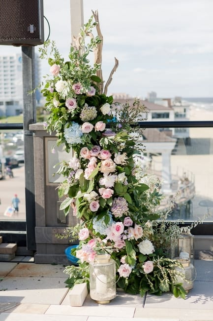 custom floral altar of pink, blush, lavendar, cream and blue florals with greens created by Magnolia West Events