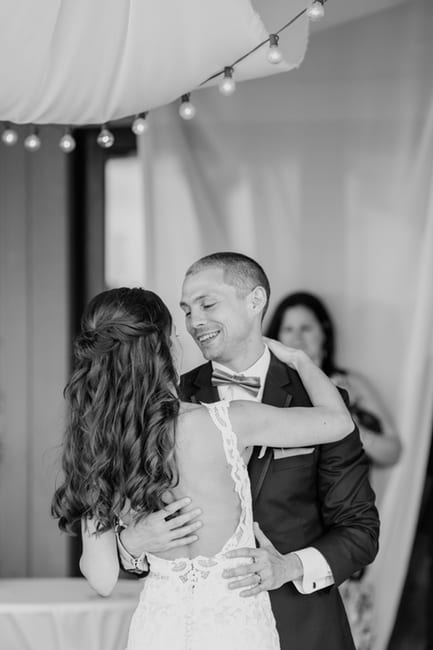 black and white photo of bride and groom during their first dance