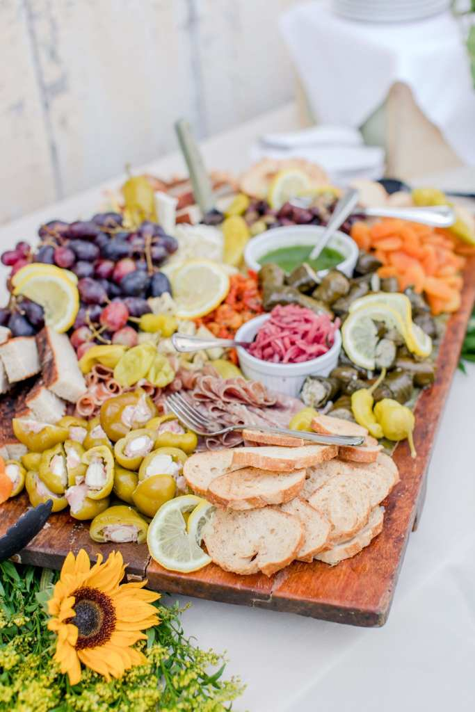 a spread of cheeses, meats and veggies by Emily's Cafe and Catering outside the barn of the Updike Farmstead