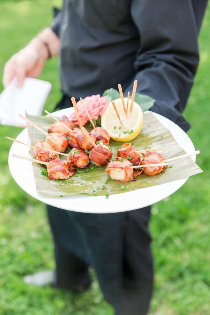 passed item of bacon wrapped scallops during cocktail hour by Emily's Cafe & Catering