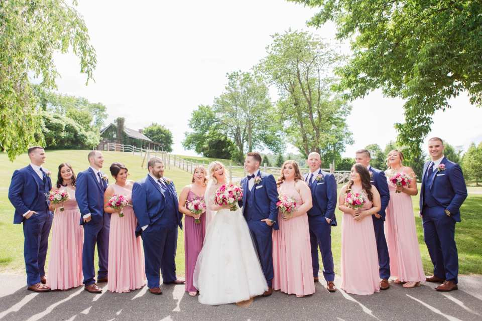 Fun photo of the entire wedding party, in a more formal line up