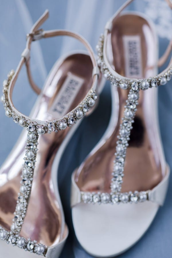 Close up of the brides Badgley Mischka t-strap rhinestone and pearl embelished heels