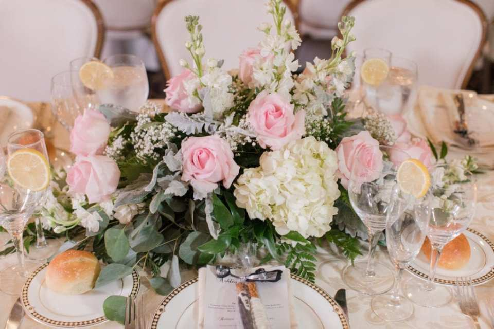 Close up of the low table arrangements of white and light pink florals by Paradise Flower Shoppe
