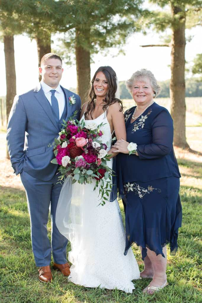 formal photo of the bride, groom, and mother of the bride