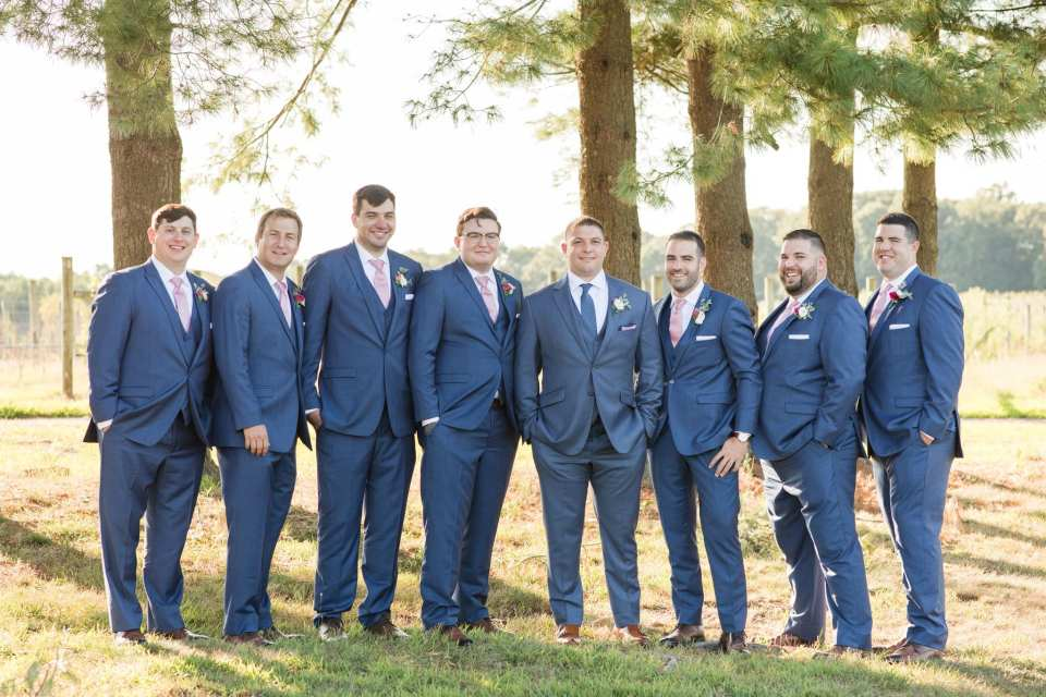 formal portrait of the groom and his groomsmen