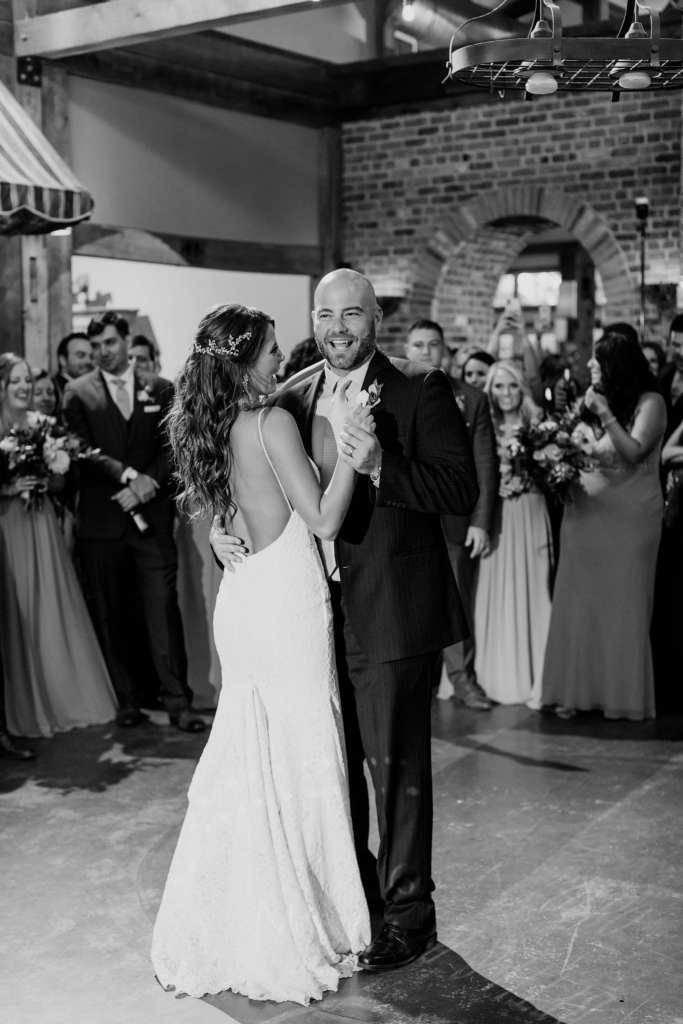 The bride shares a dance with one of her brothers