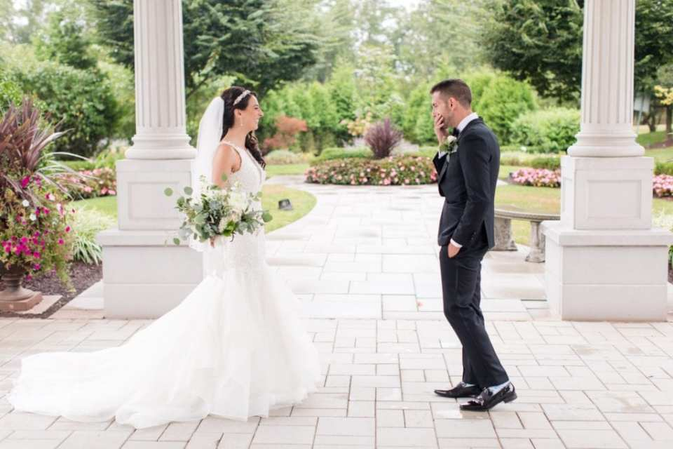 The first look between the bride and groom outside the Palace at Somerset Park before their wedding