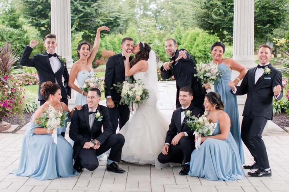 Fun bridal party photo outside the grounds of the Palace at Somerset Park