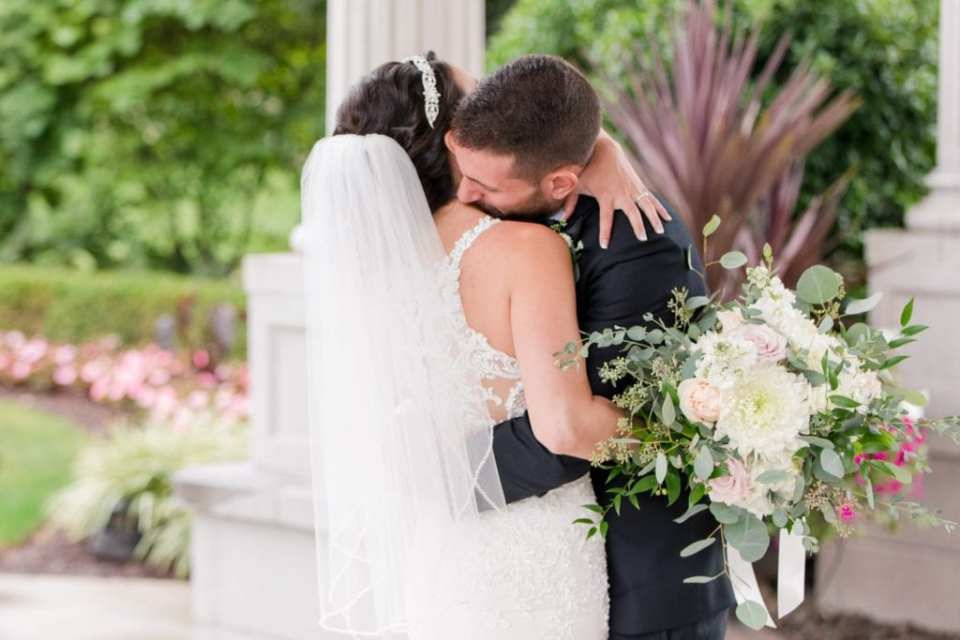 Bride and groom hug for the first time during the first look at the Palace at Somerset Park