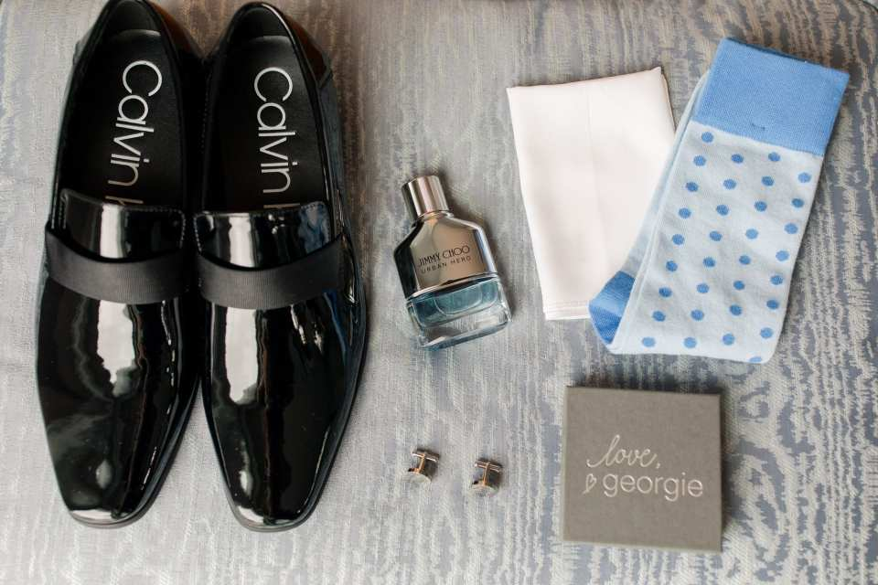 Grooms details including Calvin Klein shoes, socks, cuff links, Jimmy Choo cologne