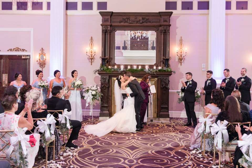 The bride and groom kiss as husband and wife during their Palace at Somerset Park wedding
