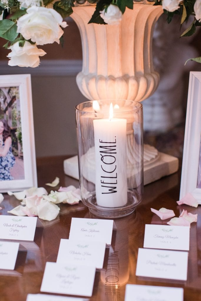 Wedding details: welcome candle along with guest placecards