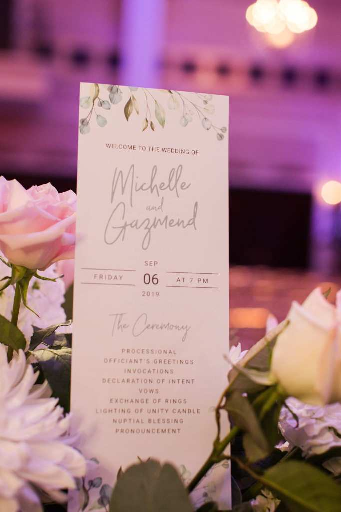 Ceremony program for the wedding in a floral arrangement by Jacquelines Florist