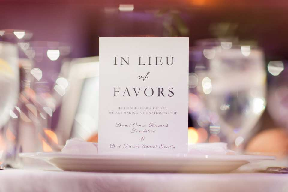 "Wedding detail photo of an ""In lieu of favor"" card"