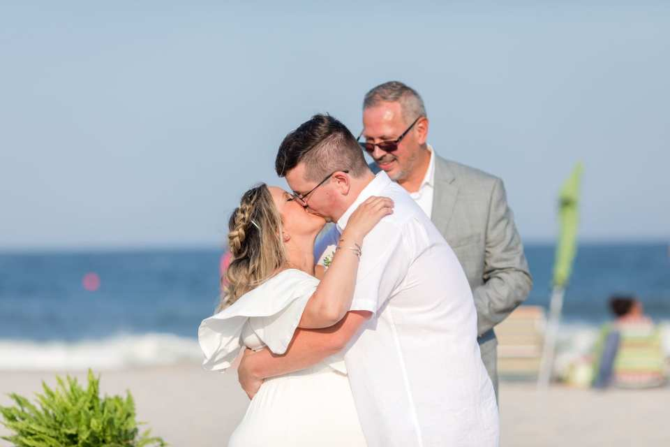 The bride and groom take their first kiss as husband and wife during their Lavallette Beach elopement