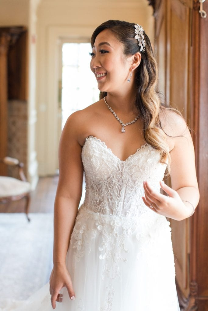 Informal bridal portrait after bride is ready in her Maggie Sottero gown