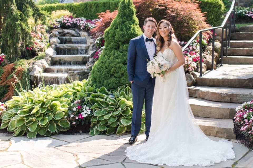 Formal portrait of the bride and groom on the property of the Park Savoy Estate