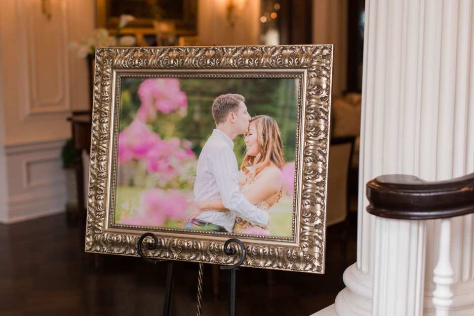 The couples engagement photo englarged and on display in a gold frame by Jaye Kogut Photography