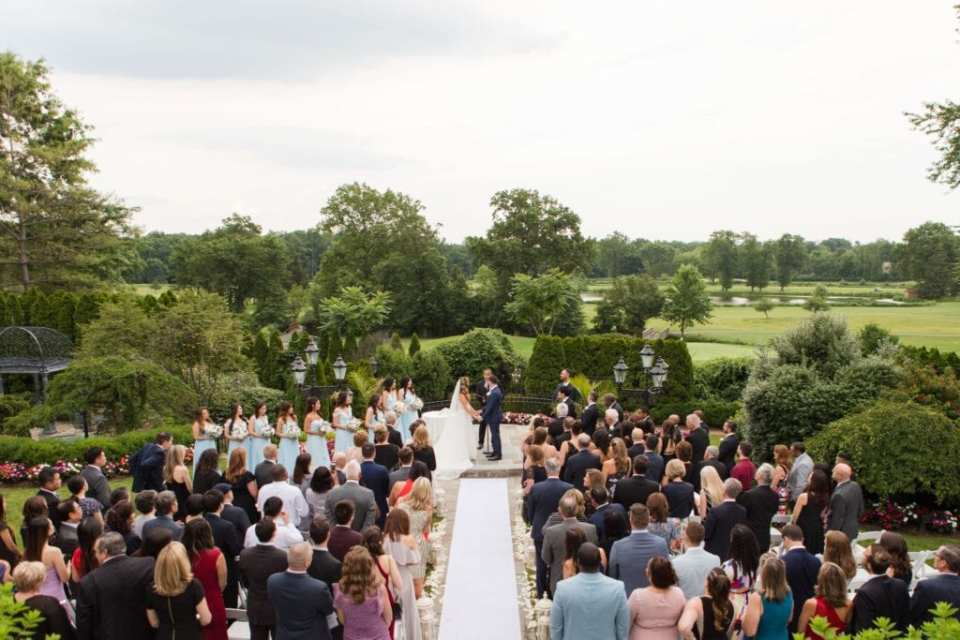 Wide angle photo of the wedding ceremony at the Park Savoy Estate